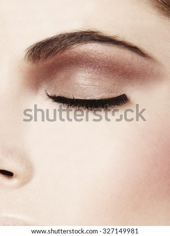 women close up closed eye with soft make up eyeshadow