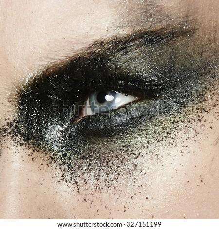 women close up eyes with dirty glitter smoky eyes make up - stock photo