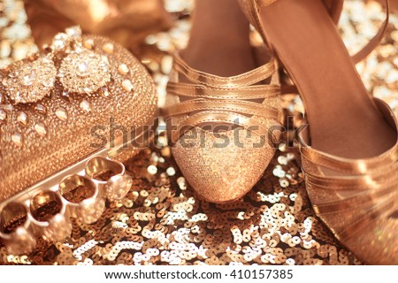 Women clothes and accessories. Golden. Fashion Shoes. Expensive Luxury jewelry   close-up background. Shiny Crystal Precious Gem Jewels - stock photo