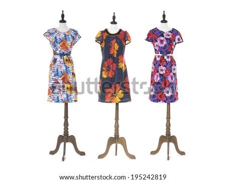 Women colorful evening dress on three dummy - full-length - stock photo