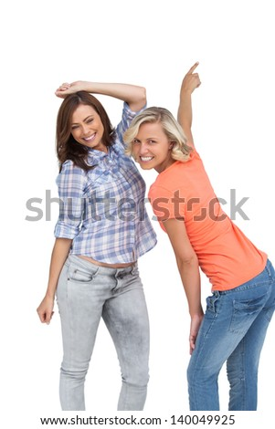 Women dancing together on white background - stock photo