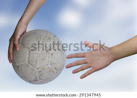 Women deprecating and hand holding a white ball blur the background sky. - stock photo