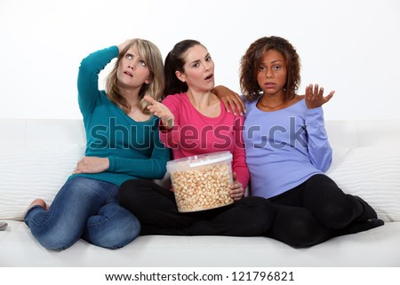 Women disappointed by the end of a movie - stock photo