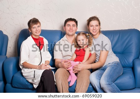 Women doctor and happy family - stock photo