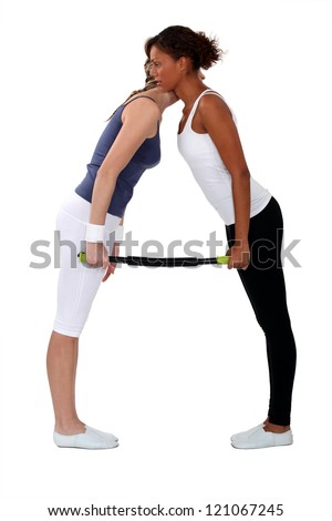 women doing exercises together - stock photo