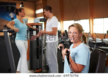 Women doing fitness exercises in a gym with fitness trainer
