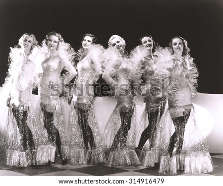 Women dressed in cellophane costumes