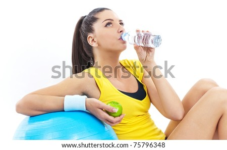 Women drinking water and holding apple, fitness time - stock photo