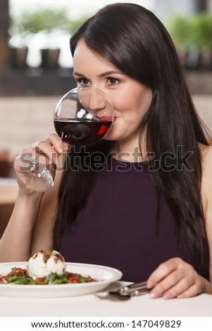 Women drinking wine. Beautiful mature women drinking wine in restaurant - stock photo