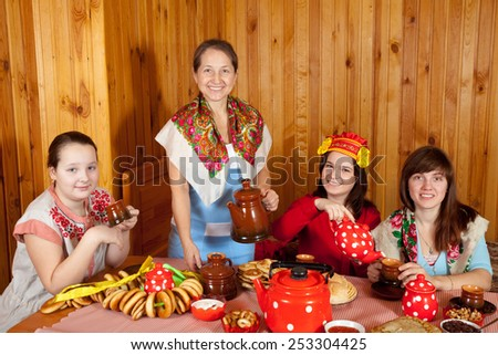 Women  drinks tea and eats pancakes  in home
