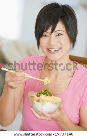 Women Eating meal,mealtime With Chopsticks - stock photo