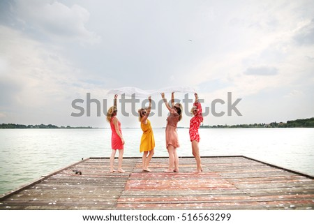 Women enjoying beautiful summer day at lake