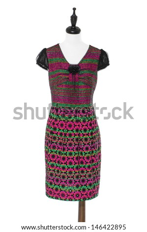 Women evening dress on a dummy isolated on a white background - stock photo