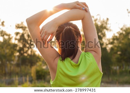 Women exercising.Women exercising in sunny bright light. - stock photo