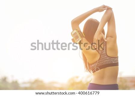 Women exercising.Women exercising in sunny bright light. - stock photo