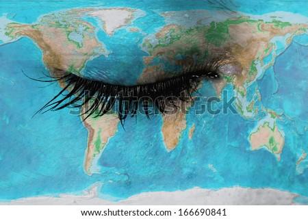 Women eye, close-up, concept of sadness, world map - stock photo
