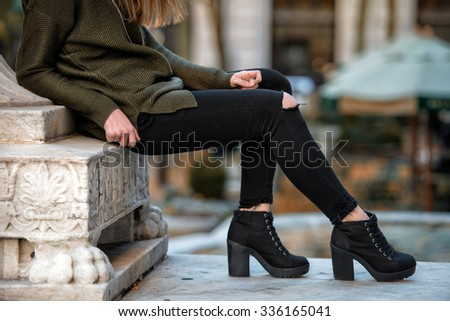 Women fall wear street style with black pants and sweater - stock photo