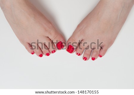 women feet after pedicure with red nails - stock photo