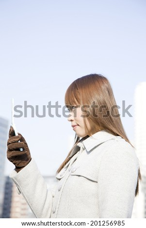 Women fiddling with mobile phone