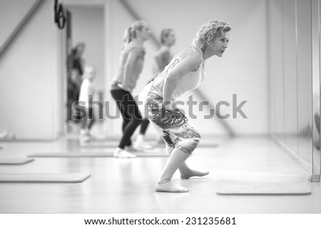 Women fitness group working out, monochrome - stock photo