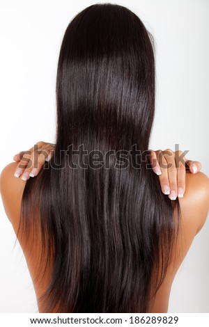 Women from back with beautiful long straight hair, studio shot