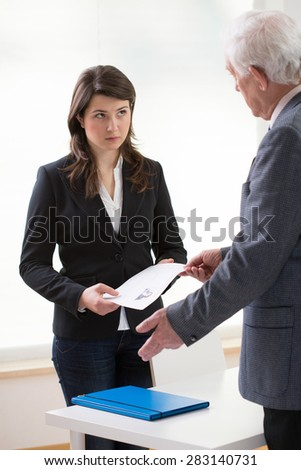 Women giving her job application to a potential boss