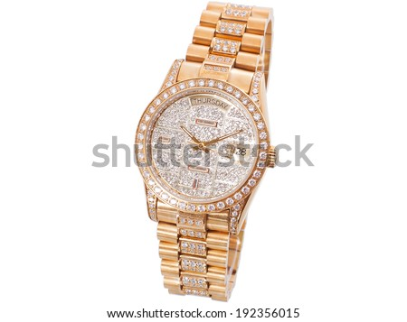 Women gold watch with the brilliants, expensive and prestigious watch on a white background without people. - stock photo