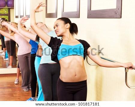 Women group in aerobics class do exercises . - stock photo