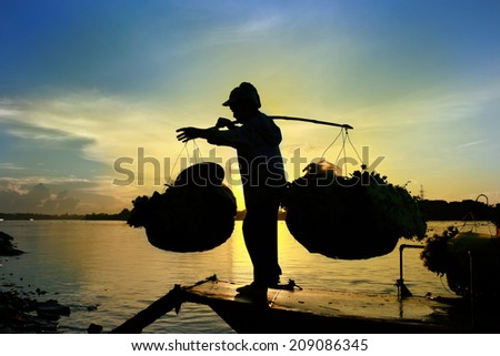 Women group selling flowers on a boat in the early morning - stock photo