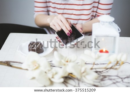 Women hand browsing a mobile phone