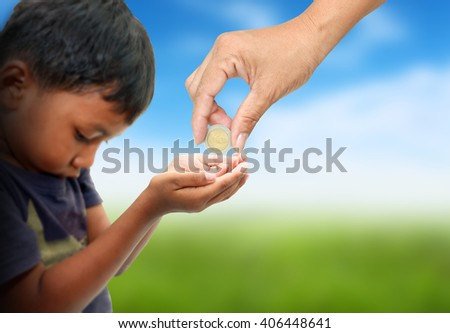 women hand give some money for poor child . - stock photo