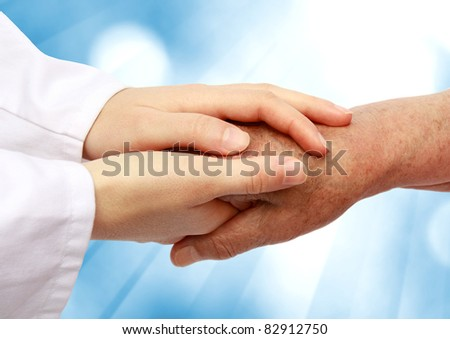 Women hand helping senior patient - stock photo