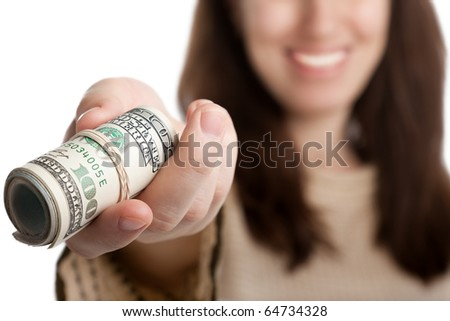 Women hand holding rolled up paper dollar currency - stock photo