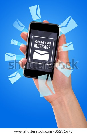 women hand holding smartphone and receiving a new message - stock photo