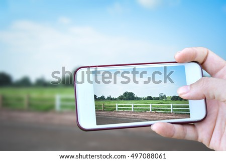 Women hand holding smartphone shooting in farm