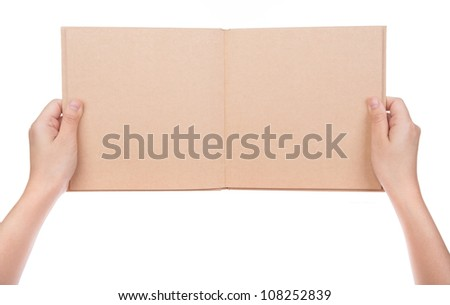 Women hand holding  vintage book isolated on white background - stock photo