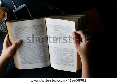 women hand open book and read,hand writing pen on paper page,hardworking for achievement business target concept, reading book for knowledge concept.  - stock photo