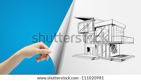 women hand turns blue page with cottage
