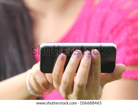 Women Hand using smartphone - stock photo