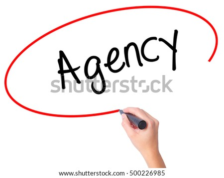 Women Hand writing Agency with black marker on visual screen. Isolated on white. Business, technology, internet concept. Stock Photo