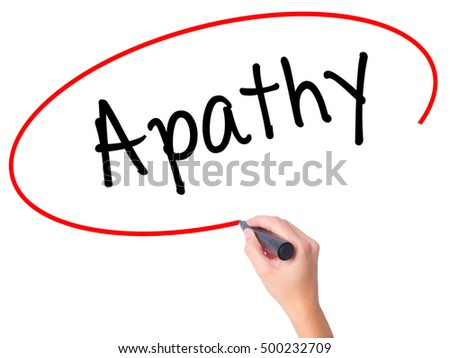 Women Hand writing Apathy  with black marker on visual screen. Isolated on white. Business, technology, internet concept. Stock Photo