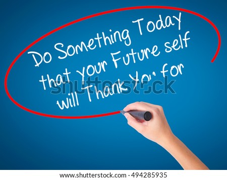 Women Hand writing Do Something Today that your Future self will Thank You for with black marker on visual screen. Isolated on blue. Business, technology, internet concept. Stock Photo