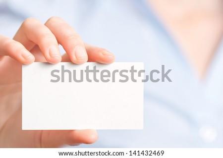 women handing a blank business card - stock photo
