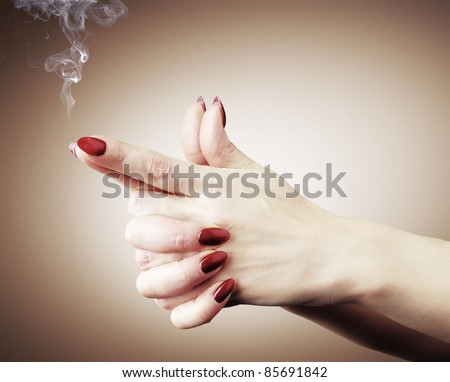 Women hands or gun with smoke, stylize color concept - stock photo