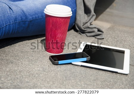 women hands with tablet computer and phone on the table - stock photo