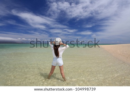 Women have a stretch on the beach. - stock photo