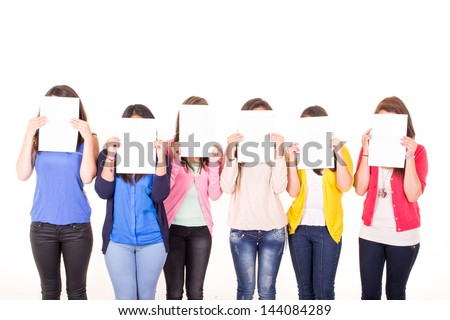 Women hiding their faces behind blank signs - stock photo