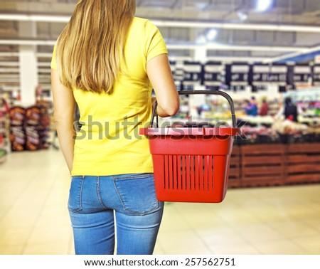 Women holding empty shopping basket - Shopping concept  - stock photo
