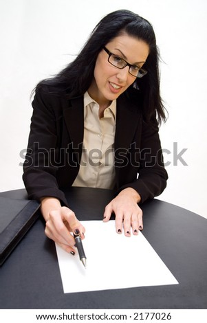 Women holding pen pointing to blank document
