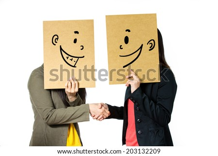 Women holding smiling face emotion - stock photo